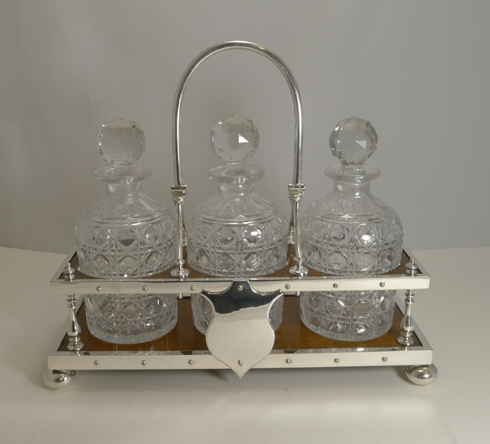 antique partner's oak and silver plate tantalus decanters dated 1885