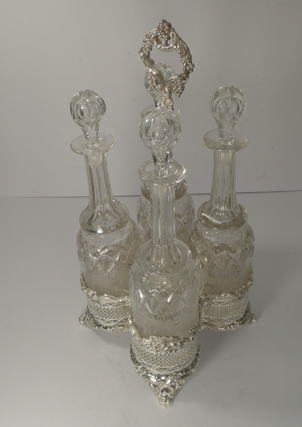 four antique english wine decanters in stand c1890