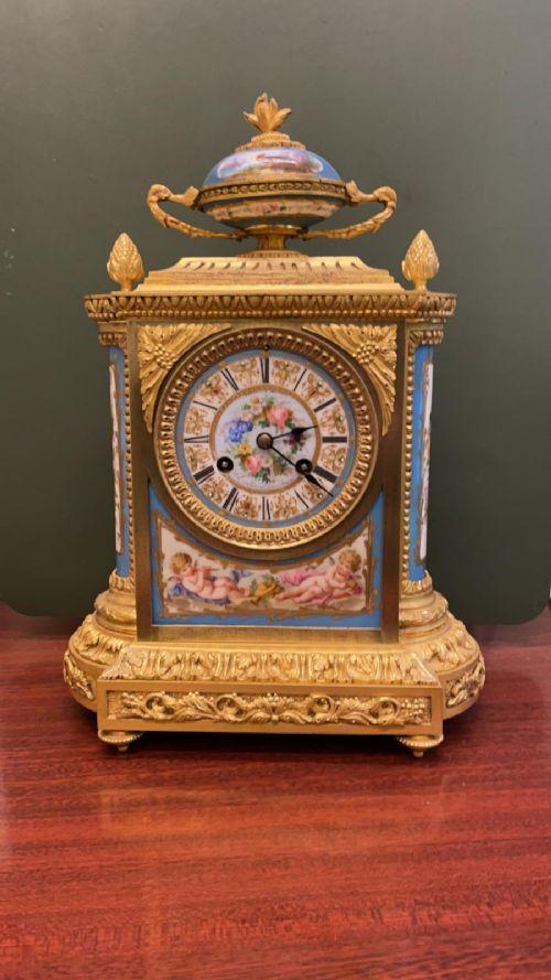 19th century ormolu and paintedporcelain striking 8day mantel clock