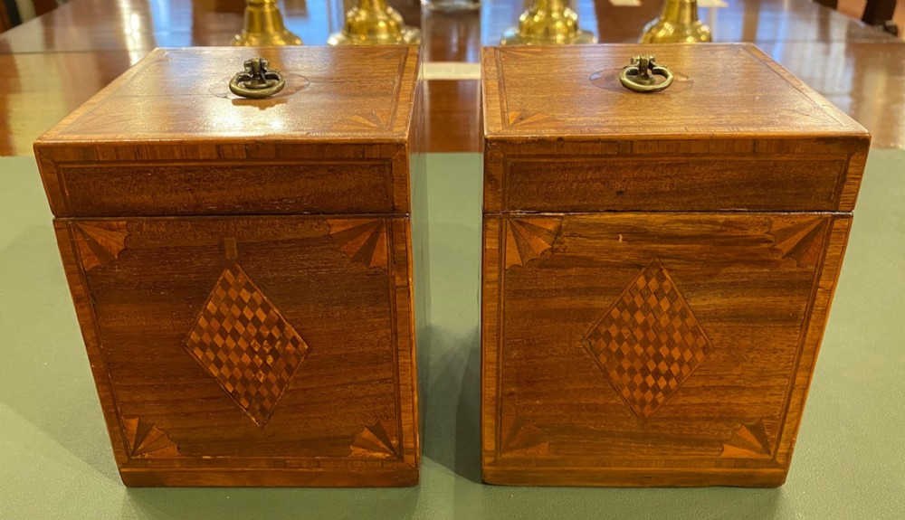 a rare pair of late 18th century inlaid mahogany cube tea caddies