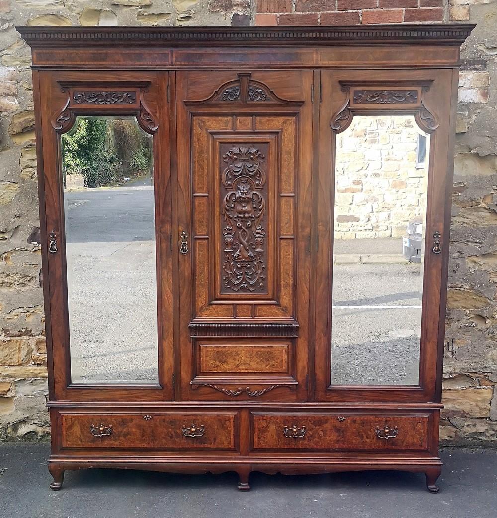 edwardian walnut triple door wardrobe with carved decoration