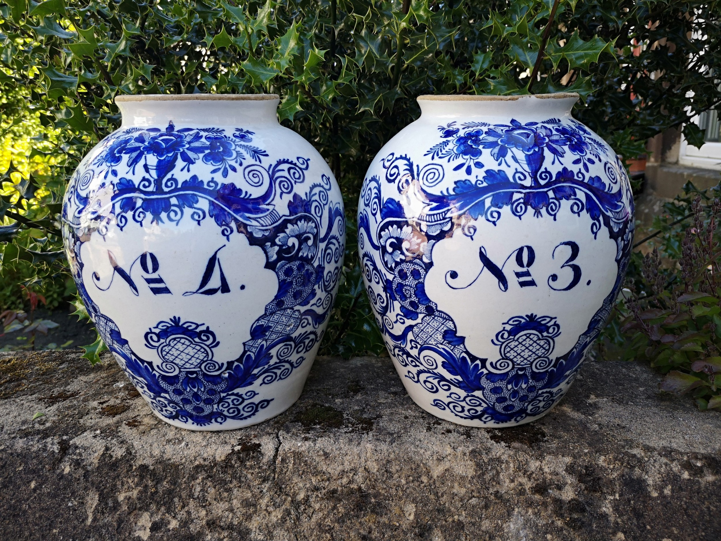 pair of blue and white 18th century delft vases
