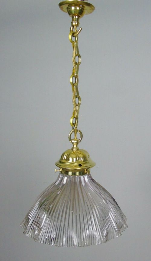 victorian brass hanging light with holophane style crimped glass shade
