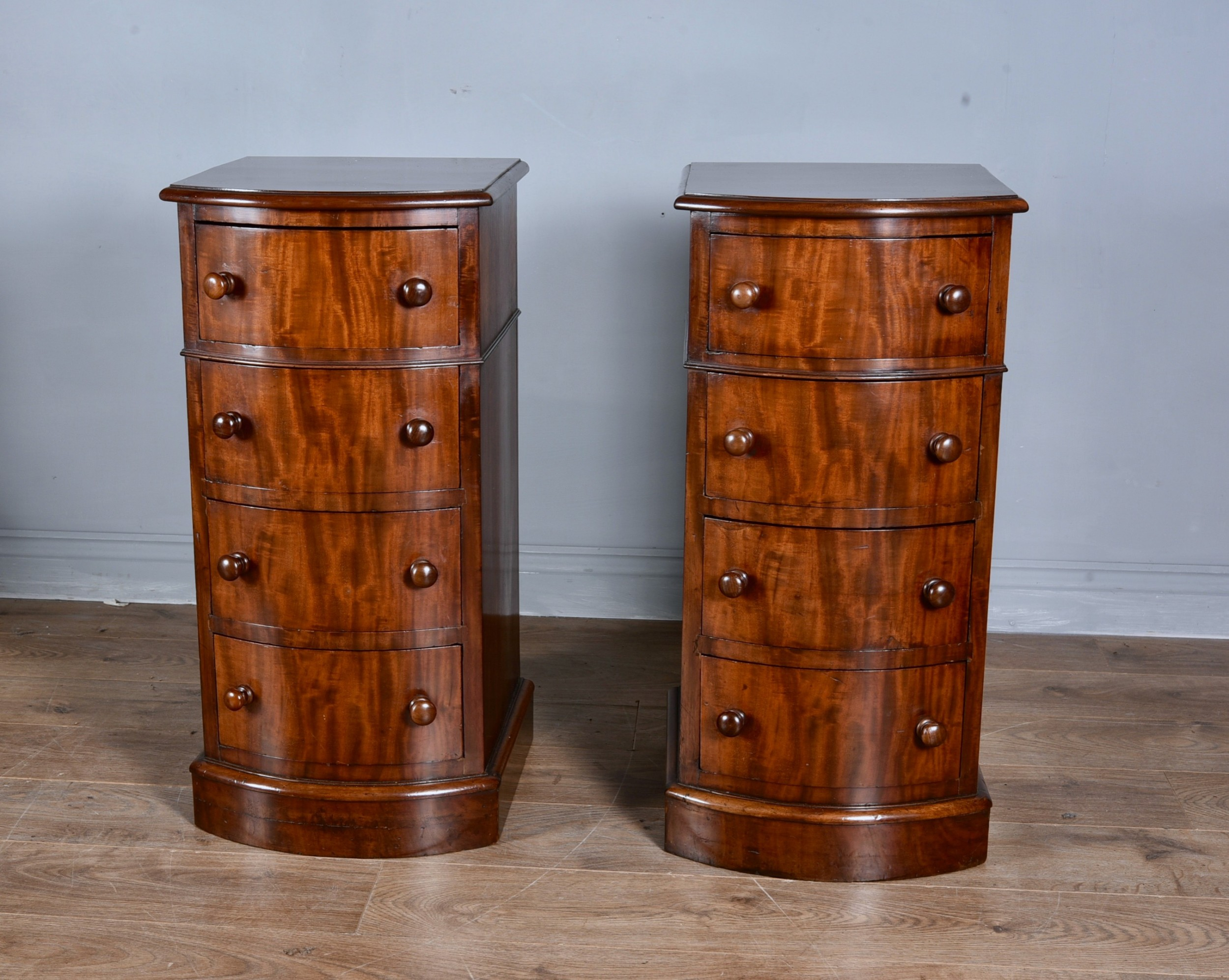 pair of mahogany bow front bedside chests of drawers