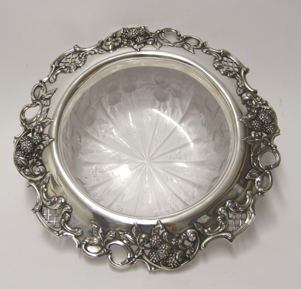 a tiffany co silver and glass bowl