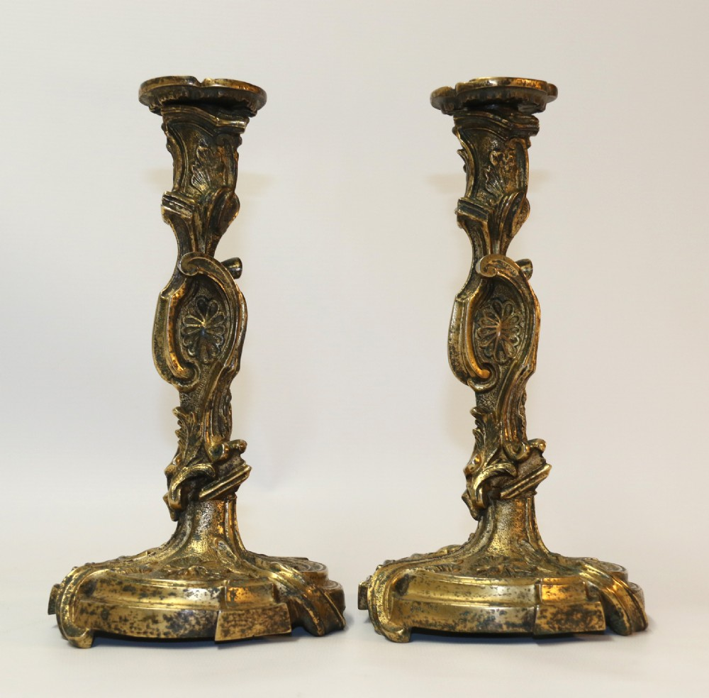 a rare pair of 18th century french gilt bronze candlesticks