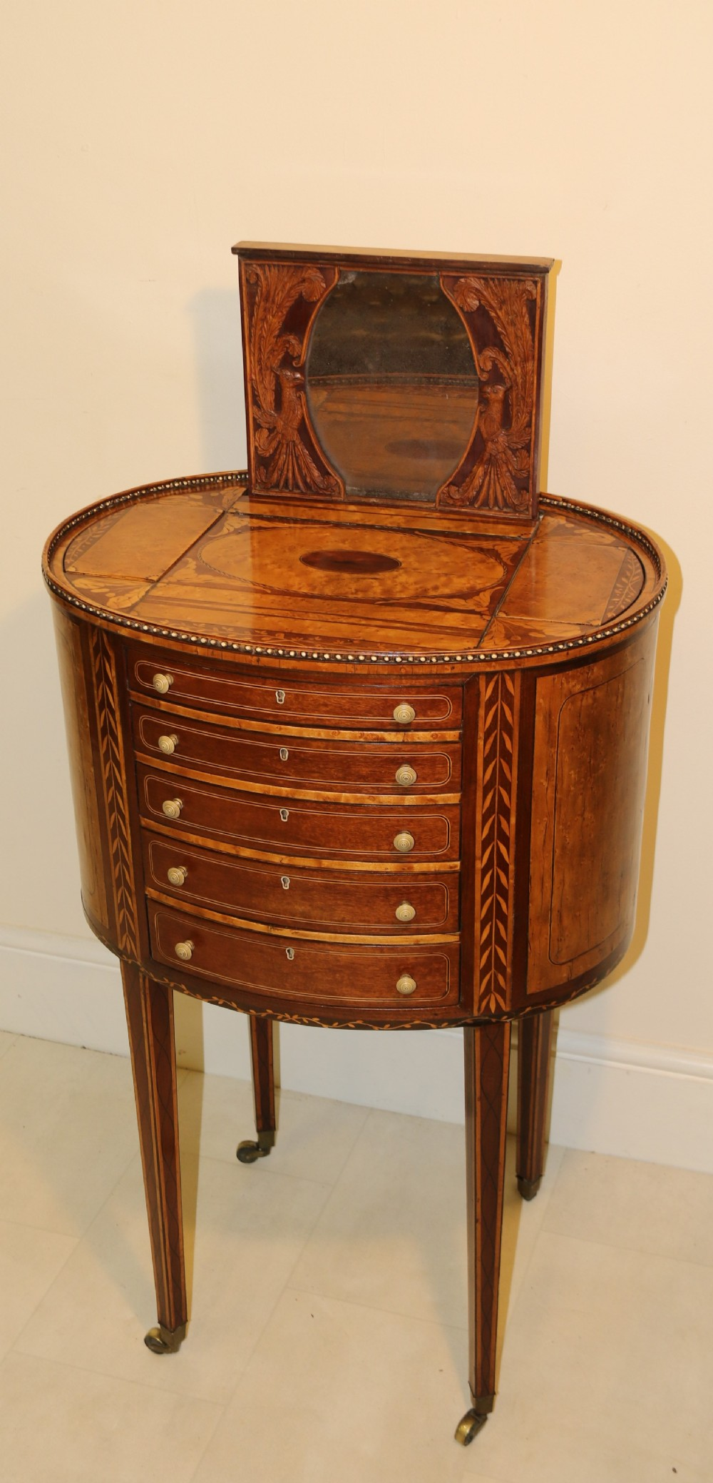 a rare and exquisite george iii ladies worktable with multiple secret rising compartments