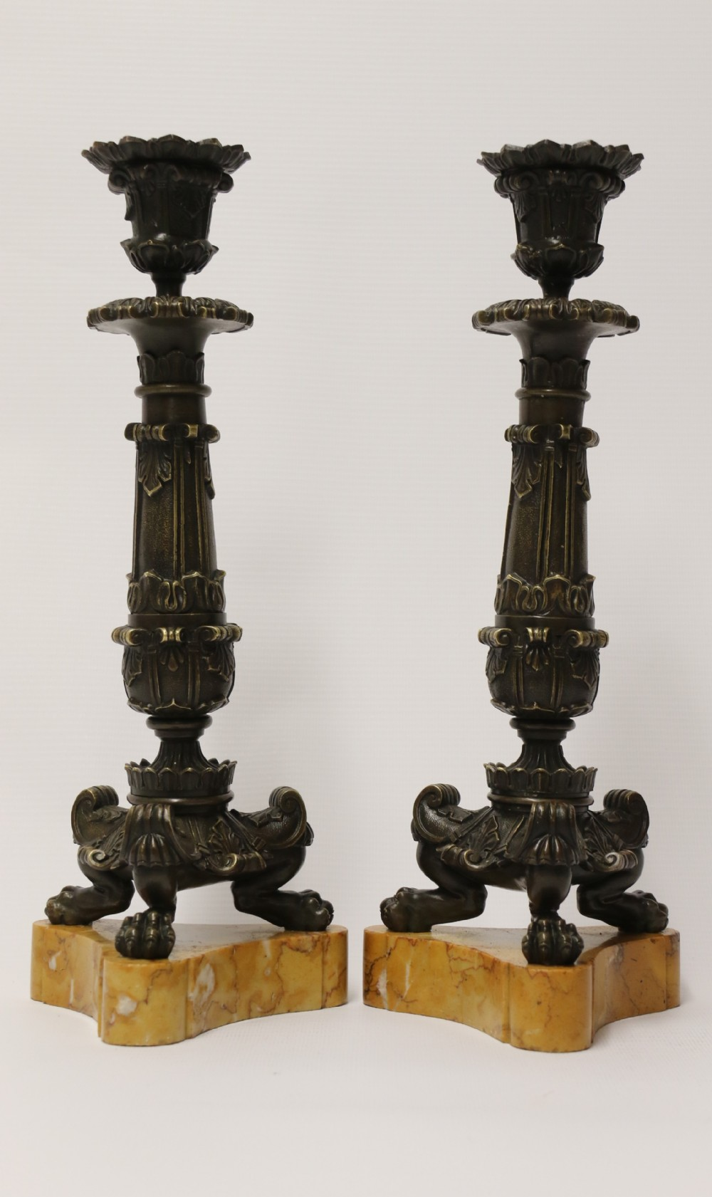 a superb pair of early 19th c french empire bronze candlesticks