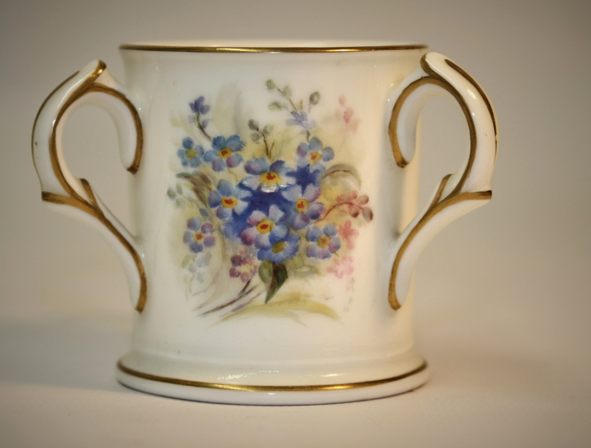 a miniature royal worcester porcelain loving cup