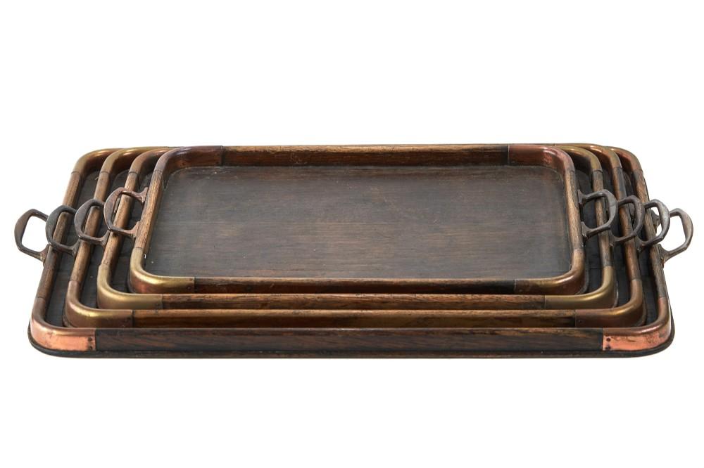 unusual set of 4 graduating antique arts crafts trays