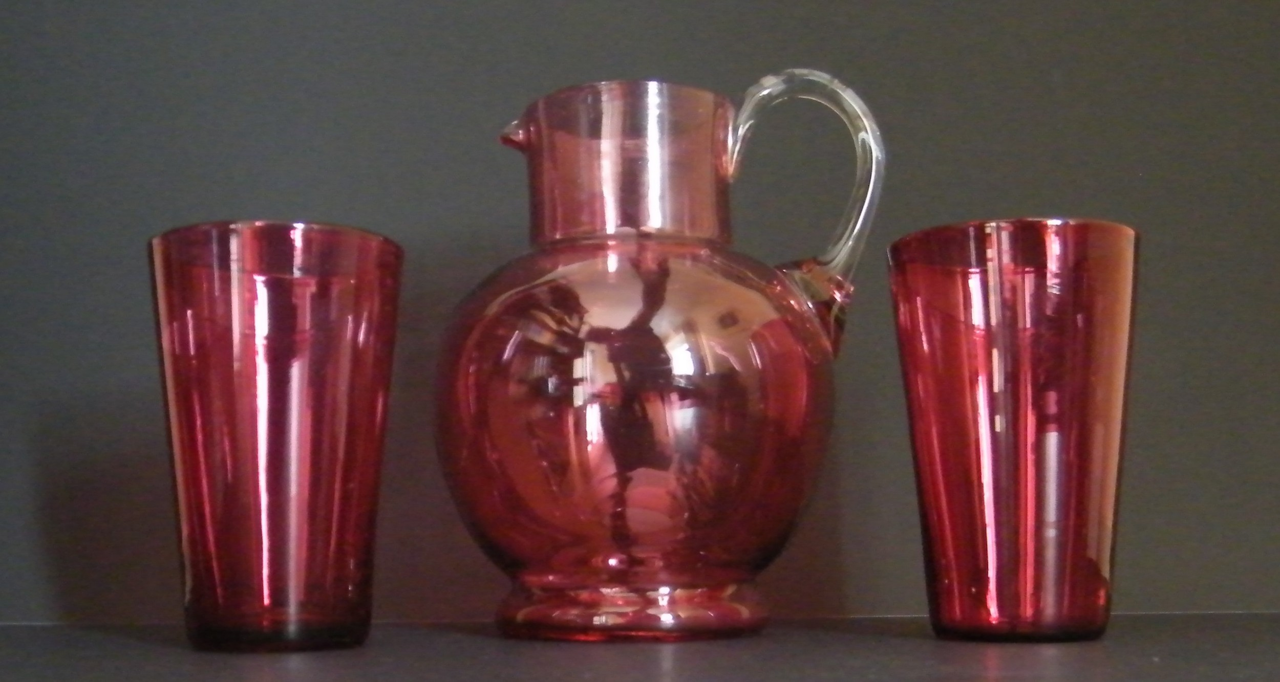 victorian cranberry glass jug and beakers