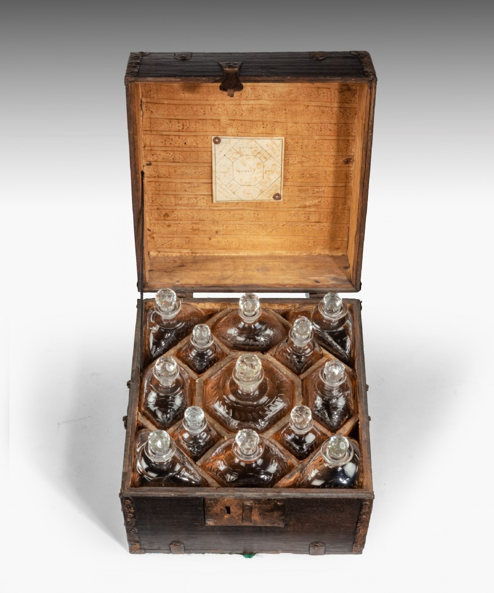eighteenth century fitted decanter box with thirteen cut glass decanters