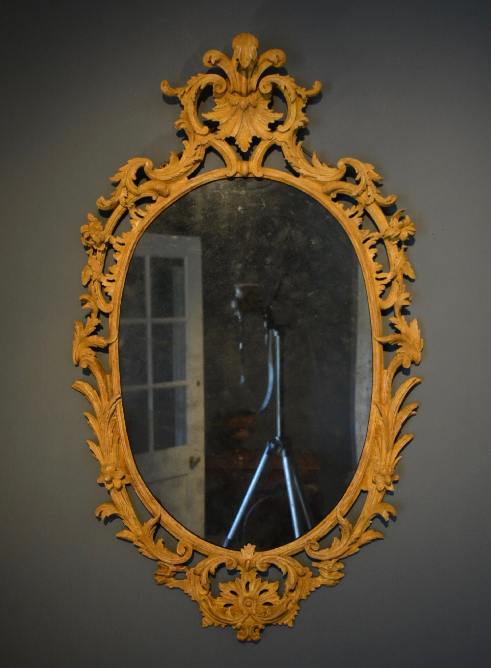 18th century finely carved oval mirror