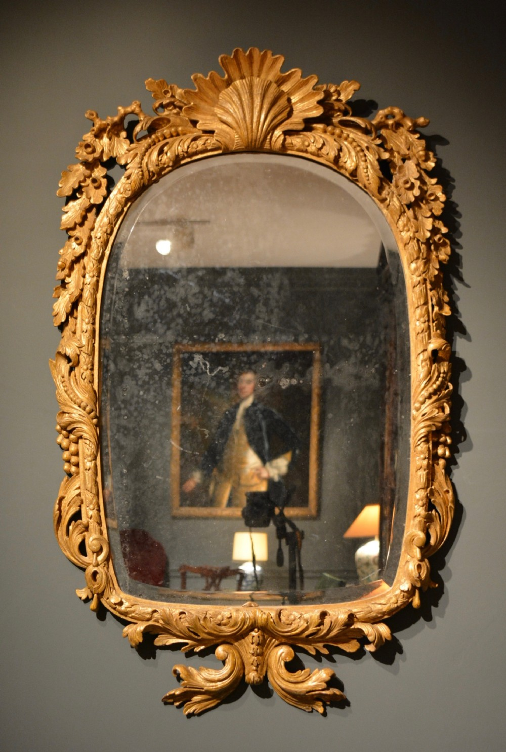 18th century carved gilt wood mirror of unusual form