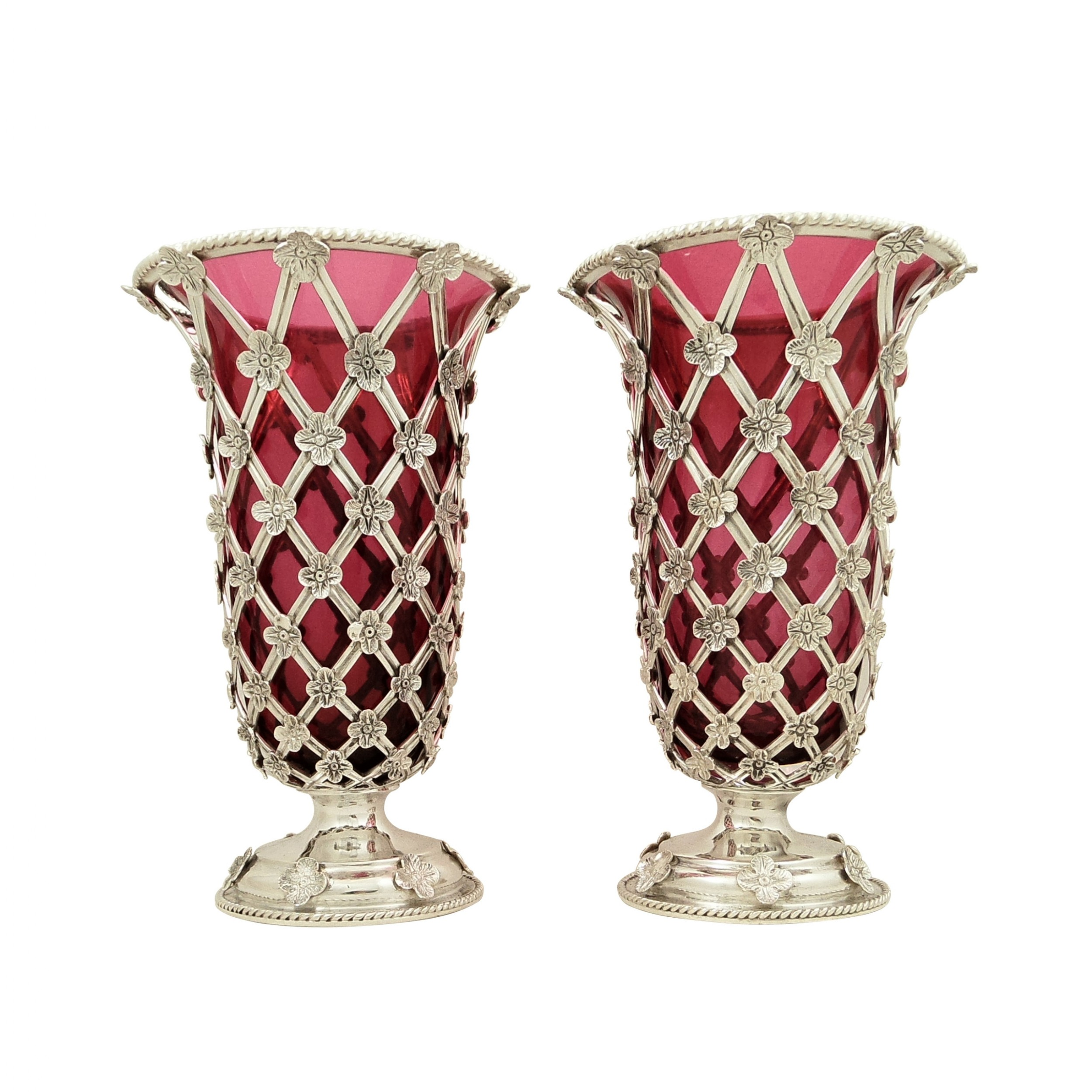 pair of antique sterling silver vases with cranberry glass liners 1910