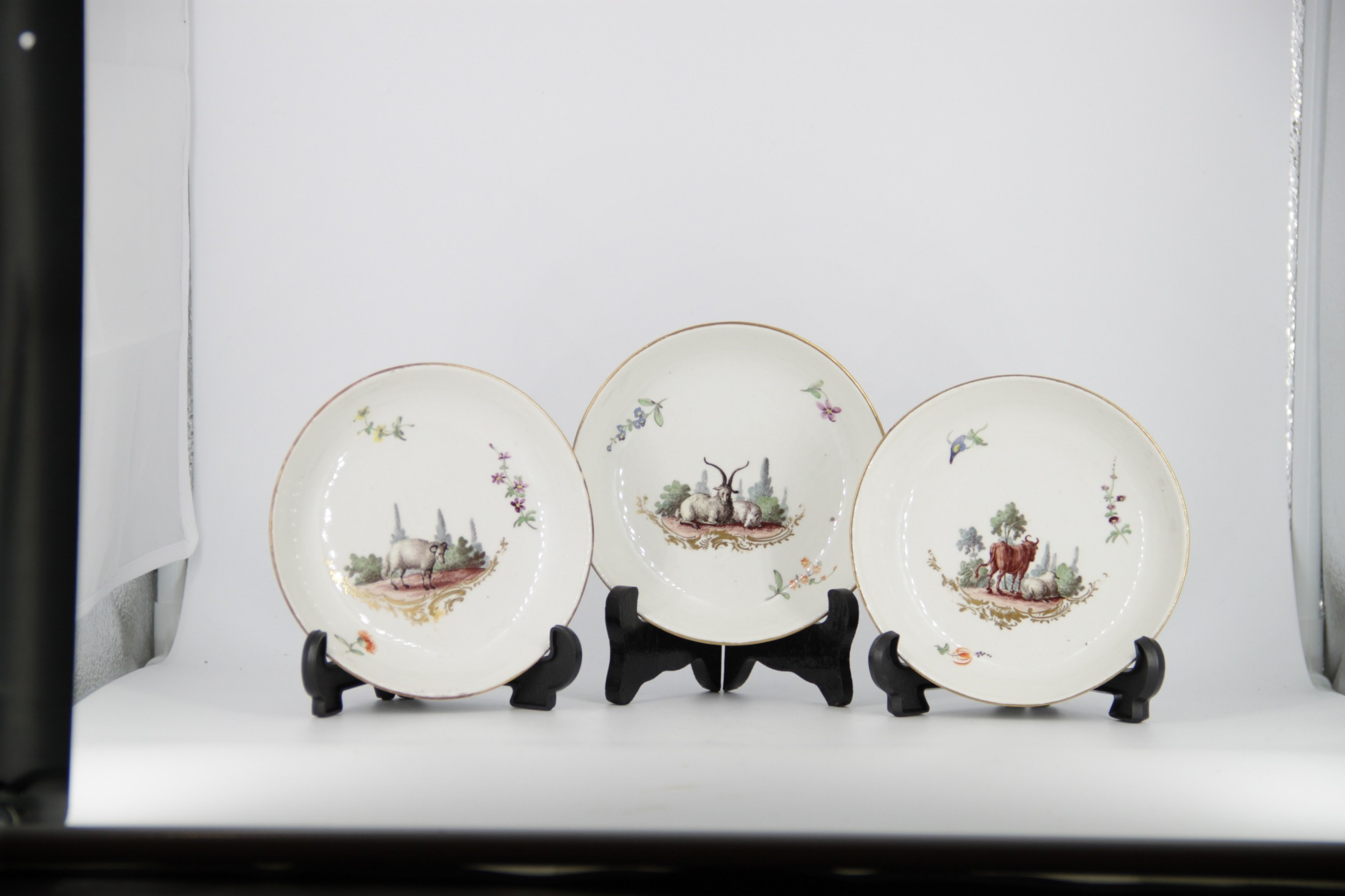 three porcelain zurich dishes