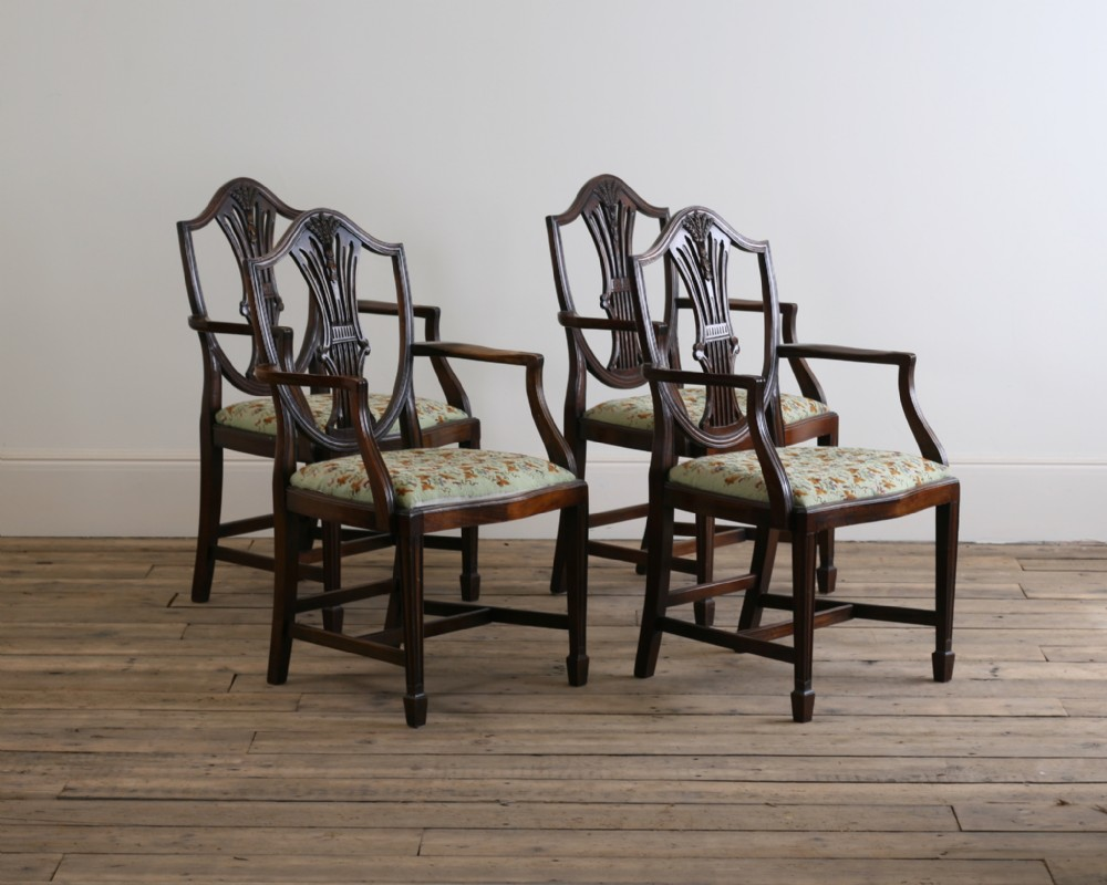 a set of 4 hepplewhite style mahogany arm chairs