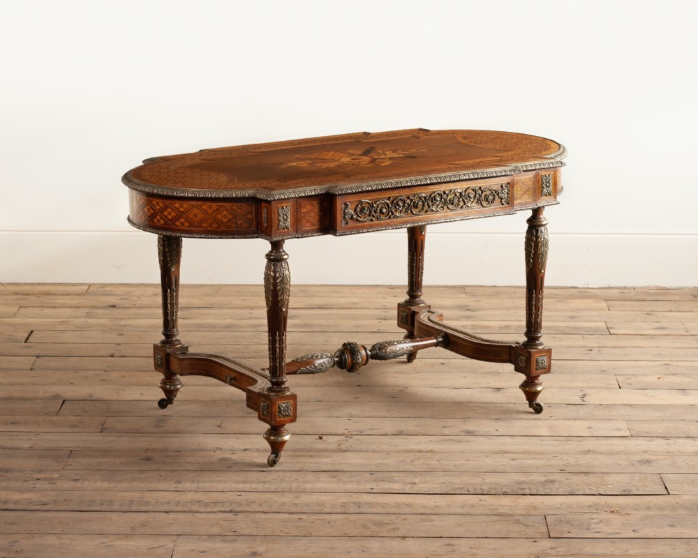 a fine victorian marquetry and parquetry ormolu mounted centre table