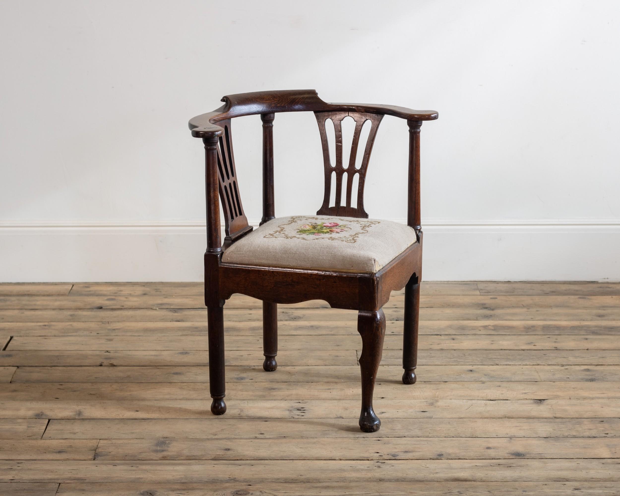 an 18th century oak corner chair