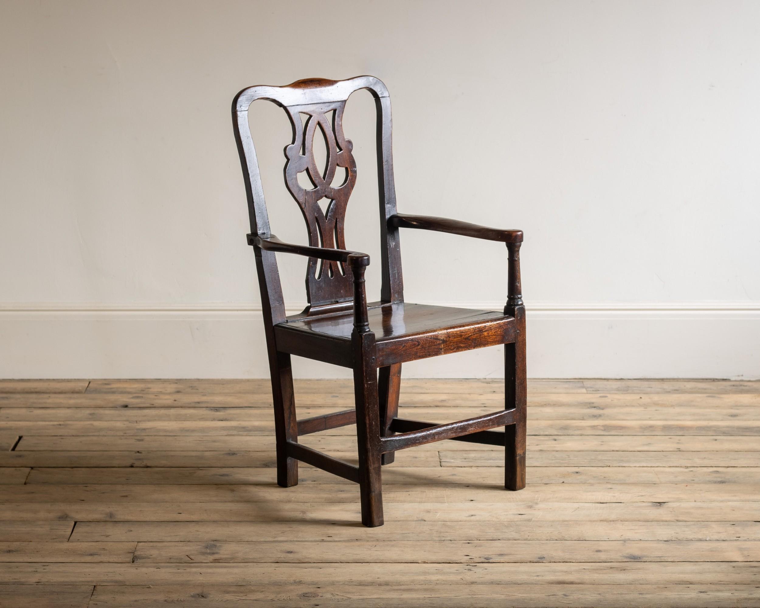 an 18th century elm arm chair