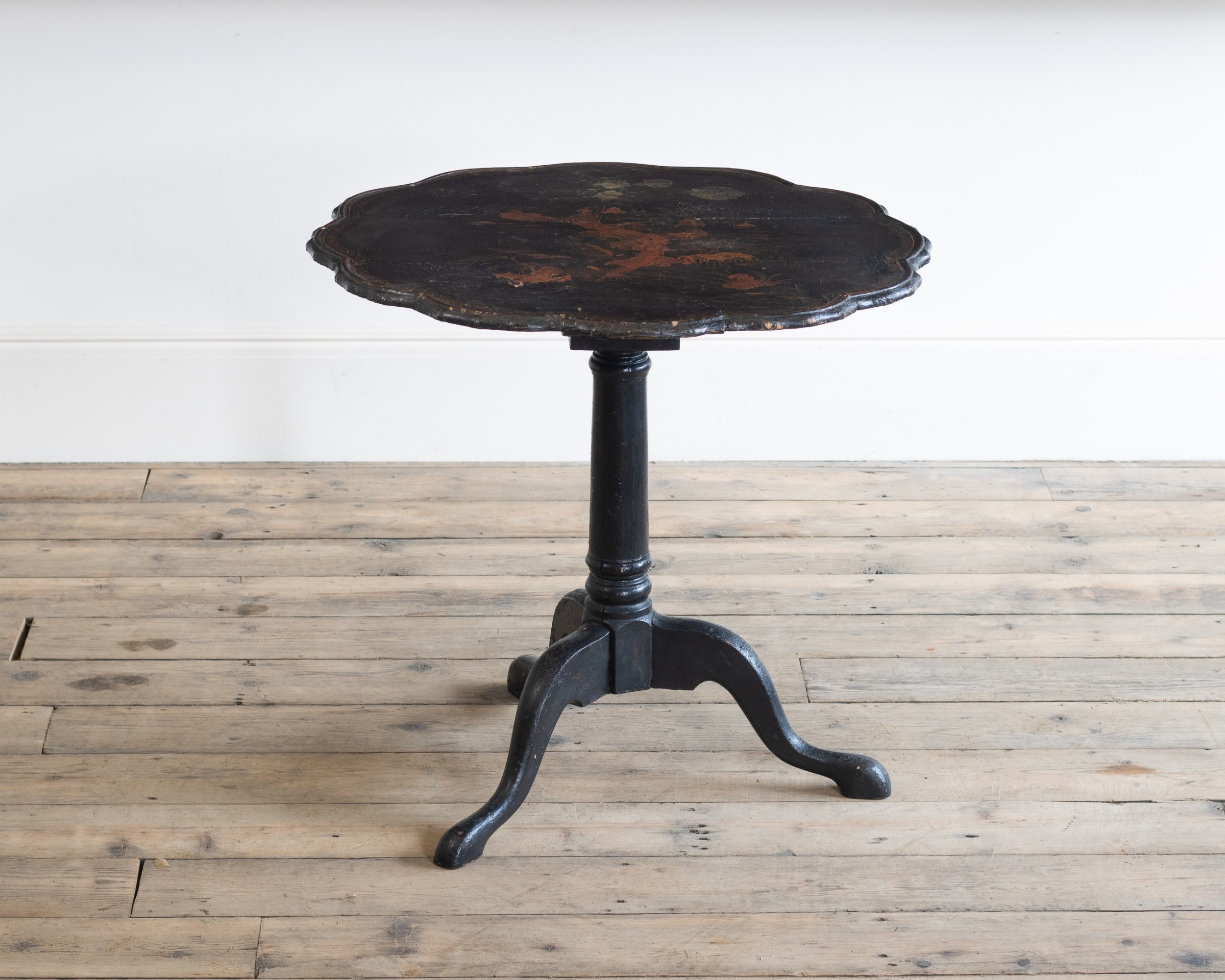 a chinese export black lacquer tripod table