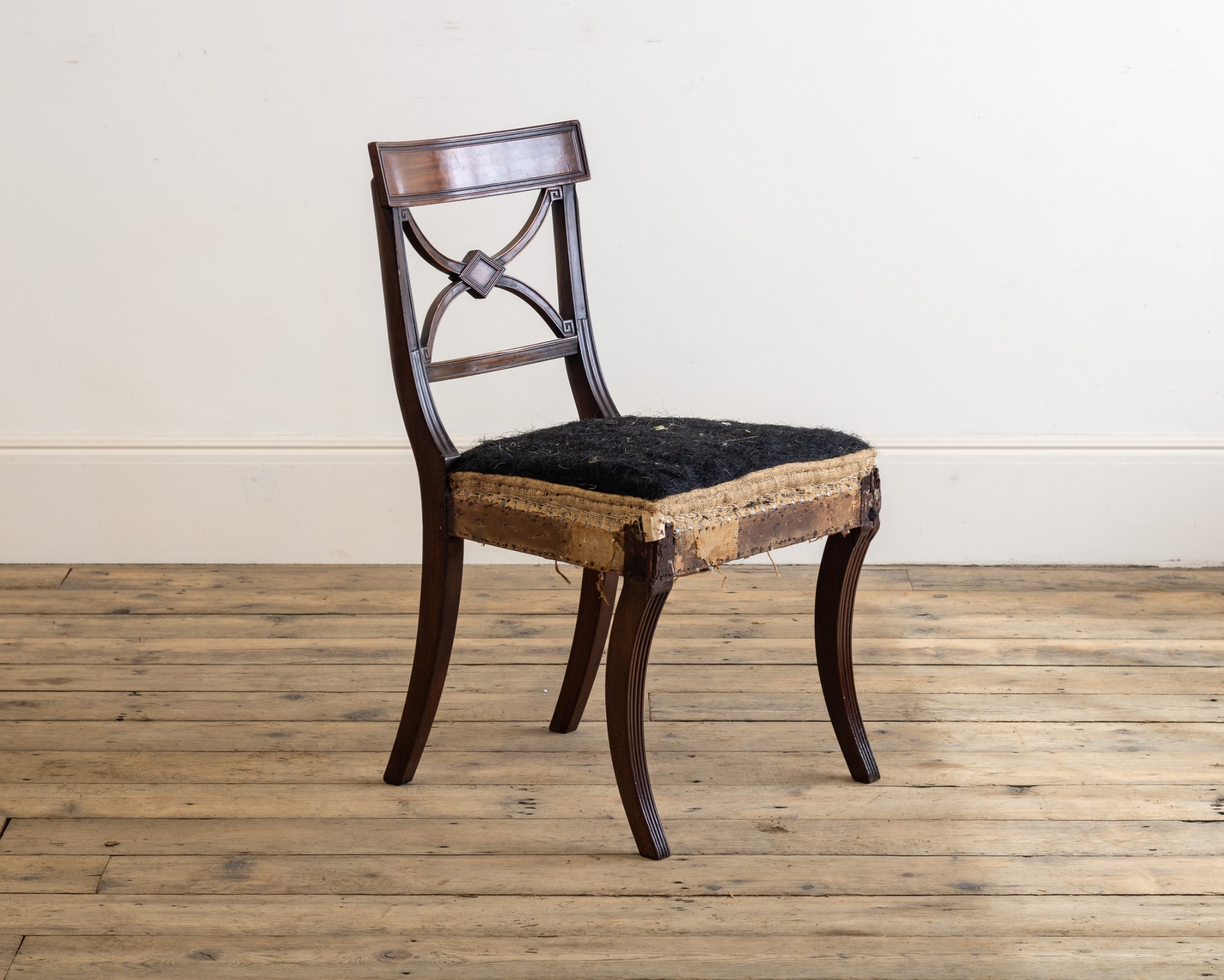 a set of four regency mahogany sabre leg side chairs