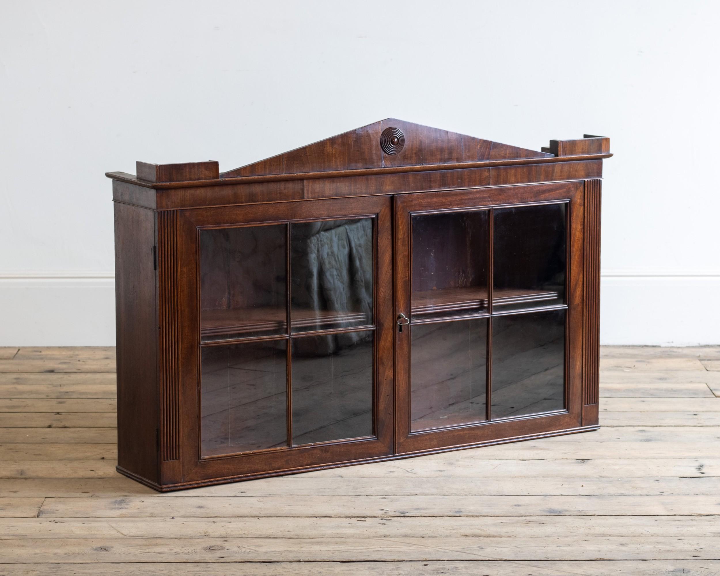 a regency glazed hanging cabinet