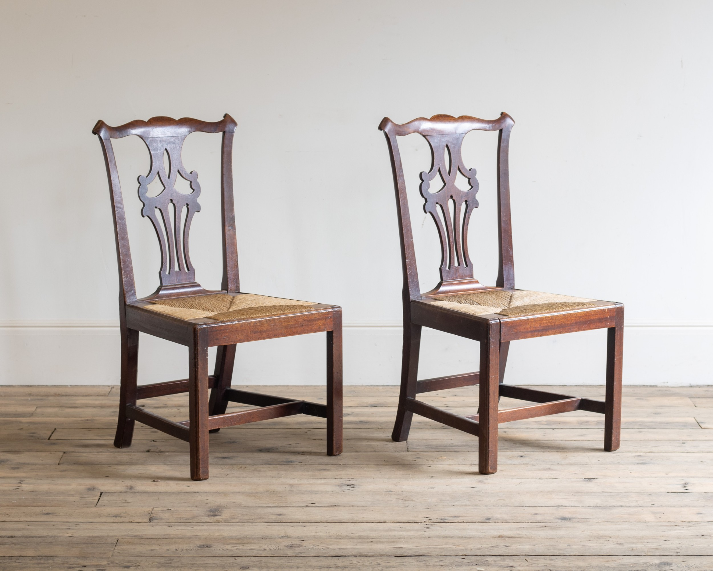 a pair of rush seated fruitwood side chairs