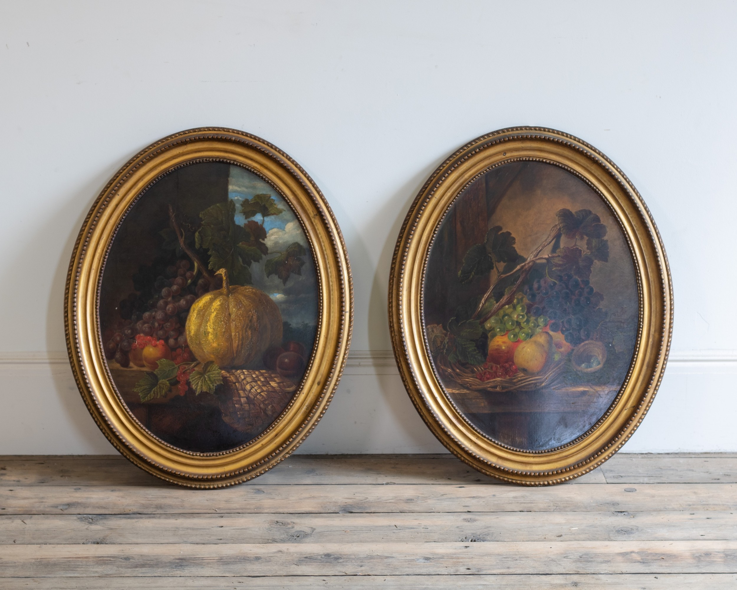 a pair of oval still life oils paintings