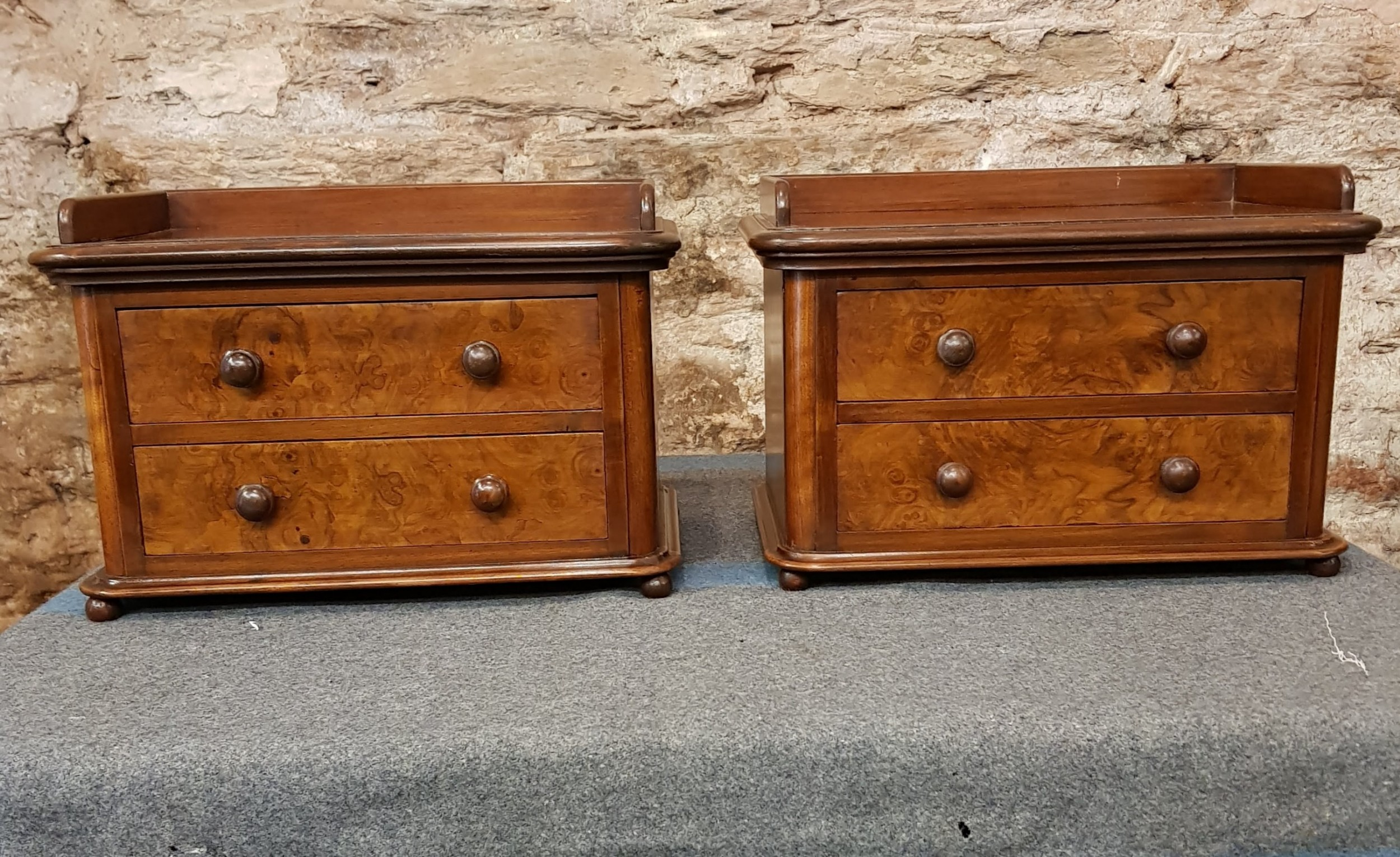 a pair of adapted tabletop chests