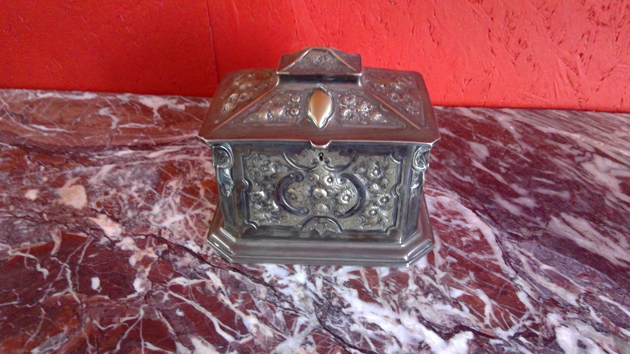 victorian silver plated embossed and engraved casket tea caddy of sarcophagus shape