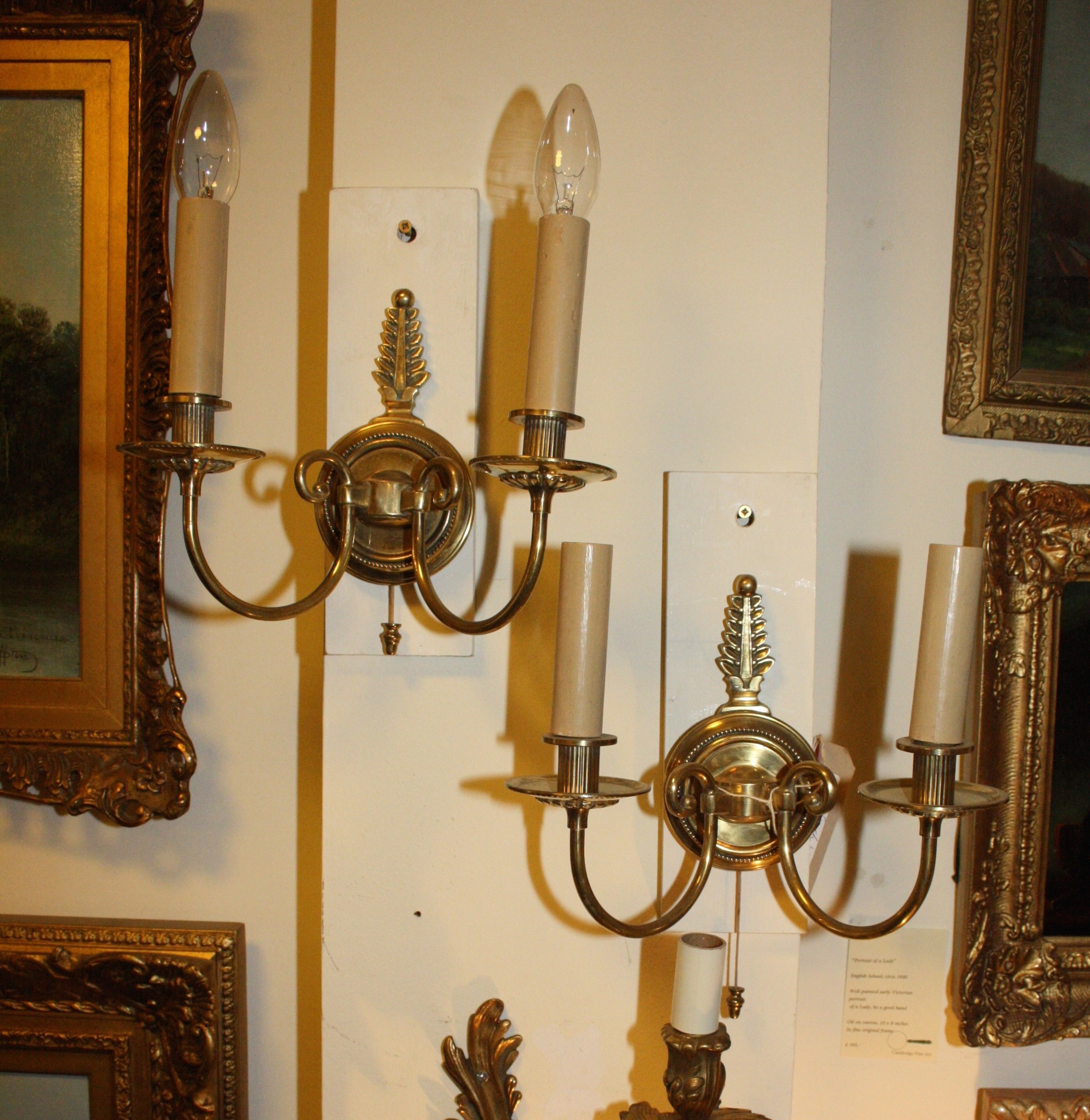 pair of french wall lights in brass with pull switch