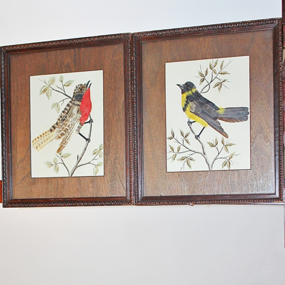 pair of feather and watercolour pictures of birds