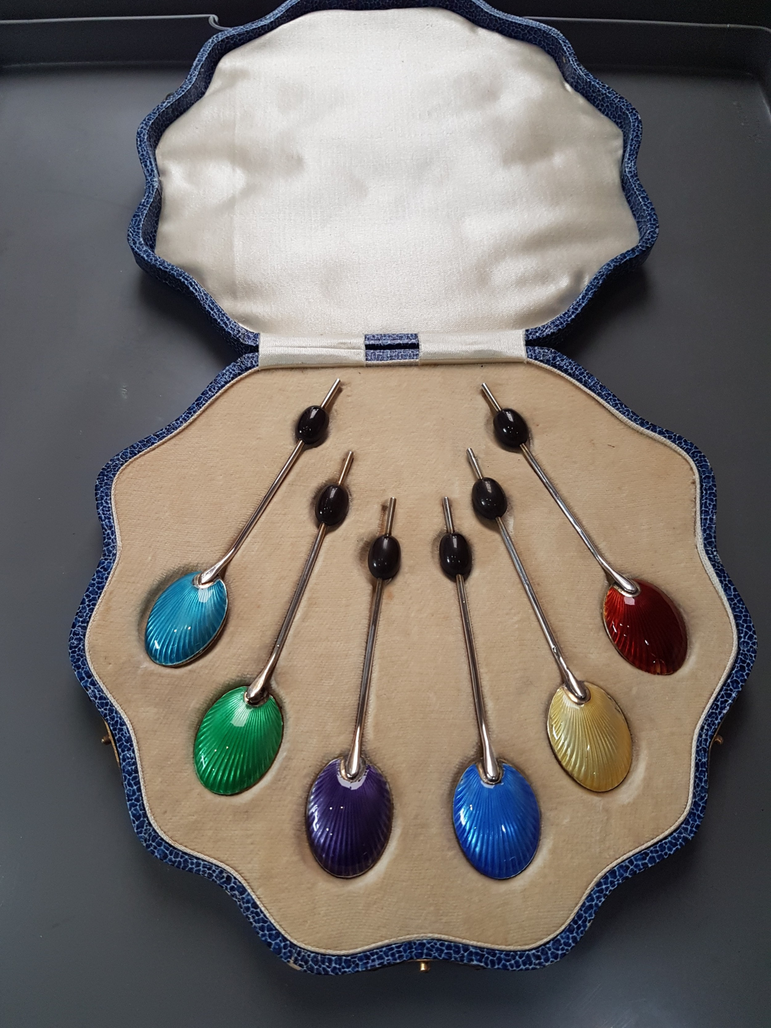 boxed set of silver and enamel spoons