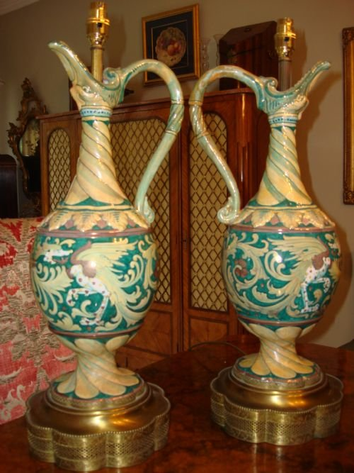stunning pair of tall 19th century hand painted ceramic lamps in an unusual design