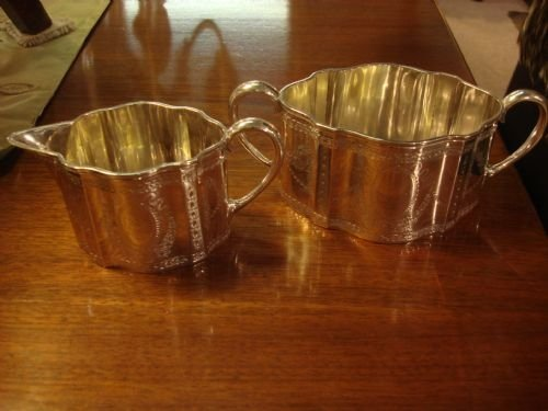 london 1875 solid silver sugar bowl and cream jug by robert hennel
