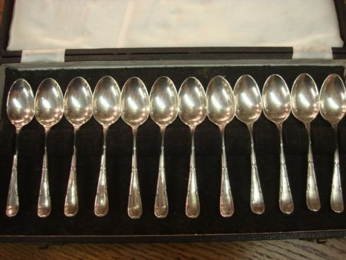 sheffield 1943 solid silver cased set of 12 coffee spoons in original fitted case by cooper brothers and sons
