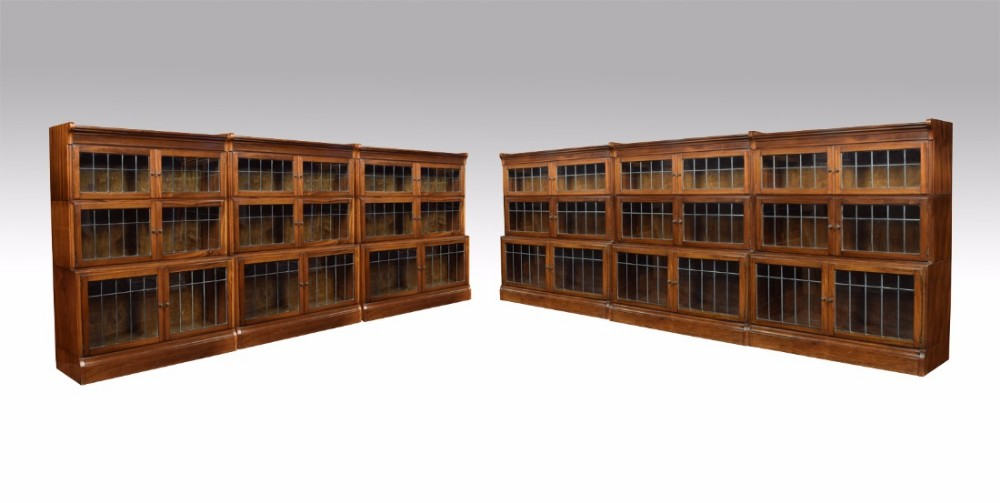 set of six walnut three sectional bookcases by minty