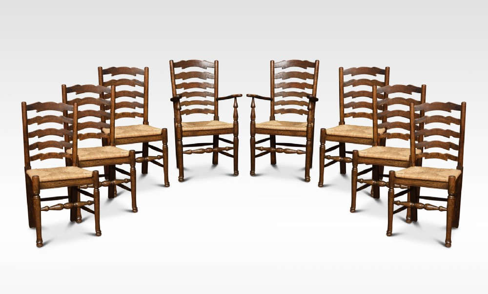 set of eight oak ladder back dining chairs