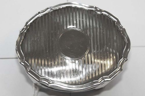 silver oval jewellery box with engine turned lid