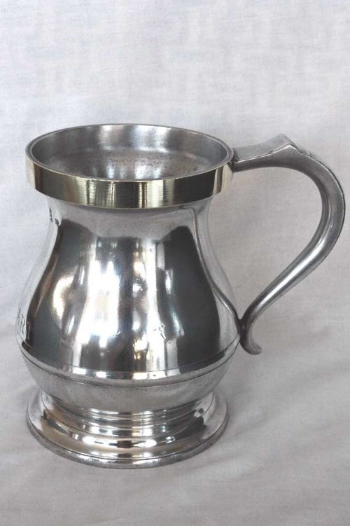 pewter pot bellied quart measure with brass lip