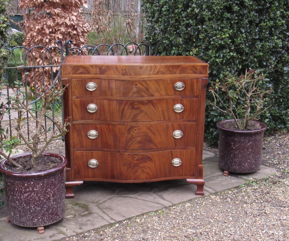 mid 19th century inlaid mahogany serpentine chest of drawers