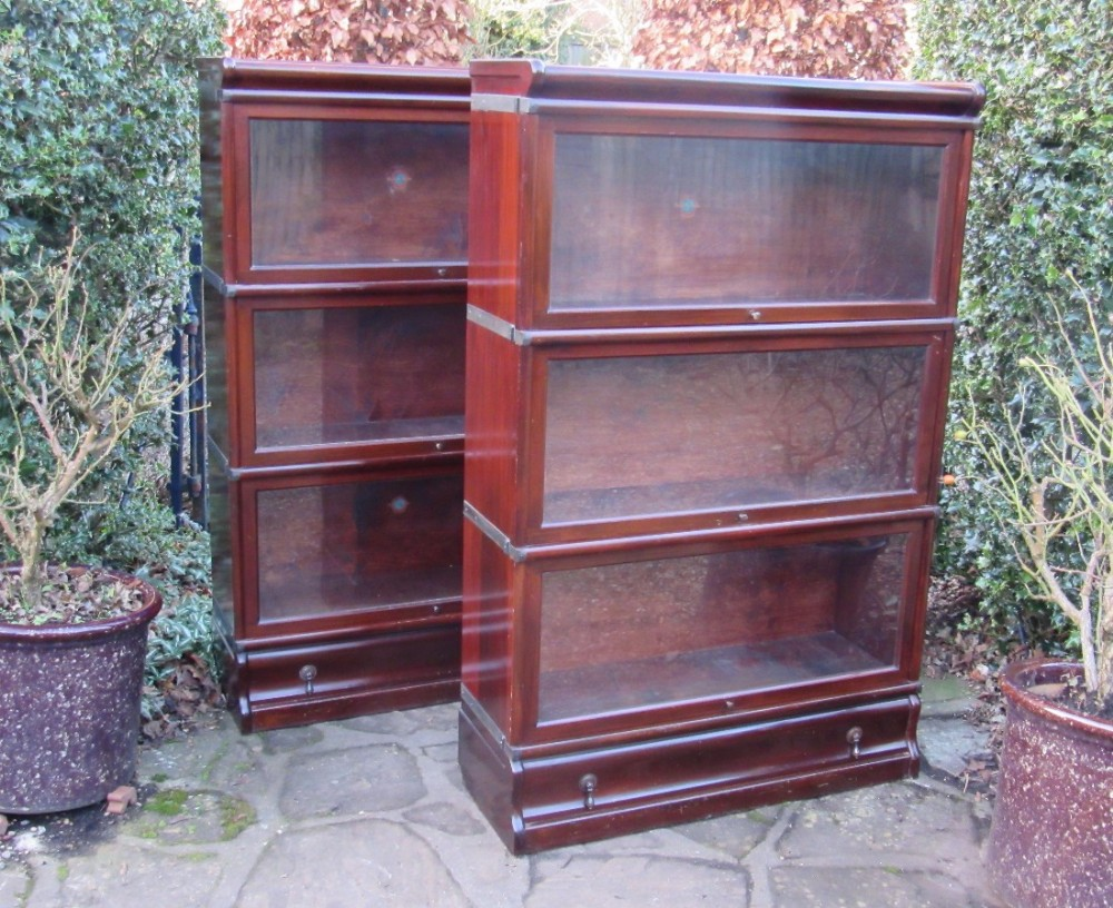 pair of 3 section mahogany globe wernicke bookcases circa 1920