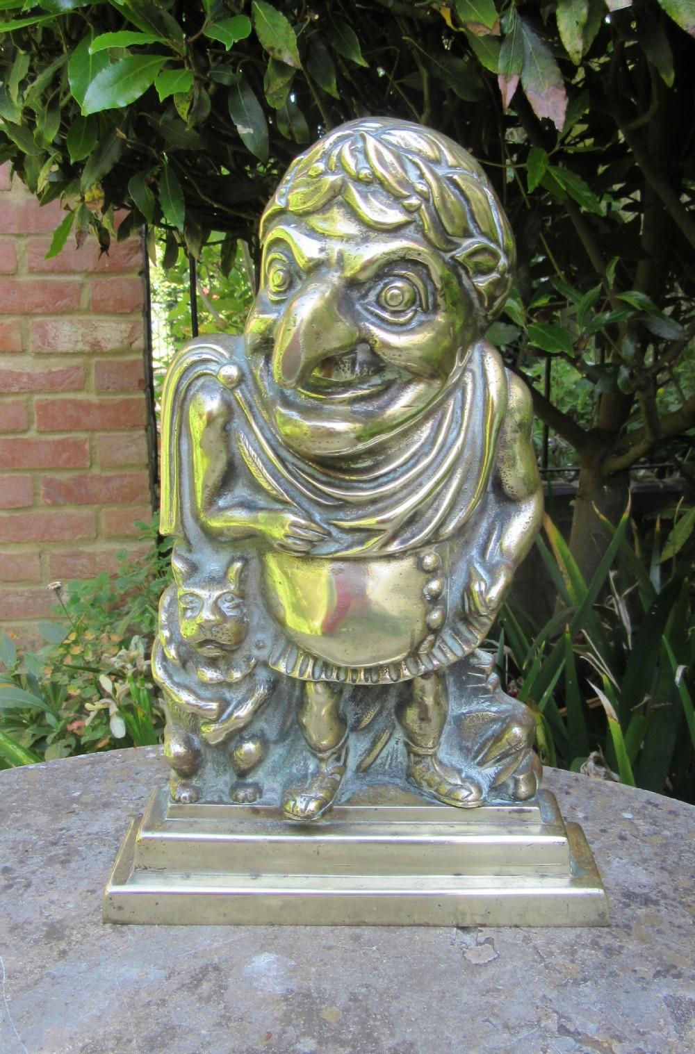 mr punch as julius caesar victorian brass door stop door porter doorstop