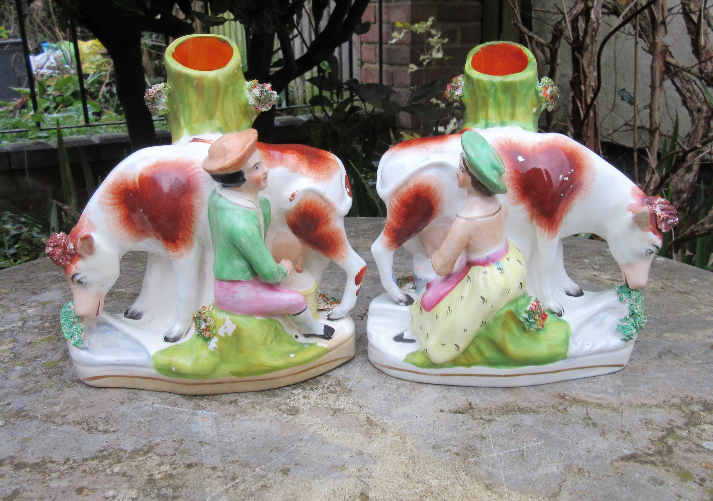 pair of staffordshire cow milking figures c1860