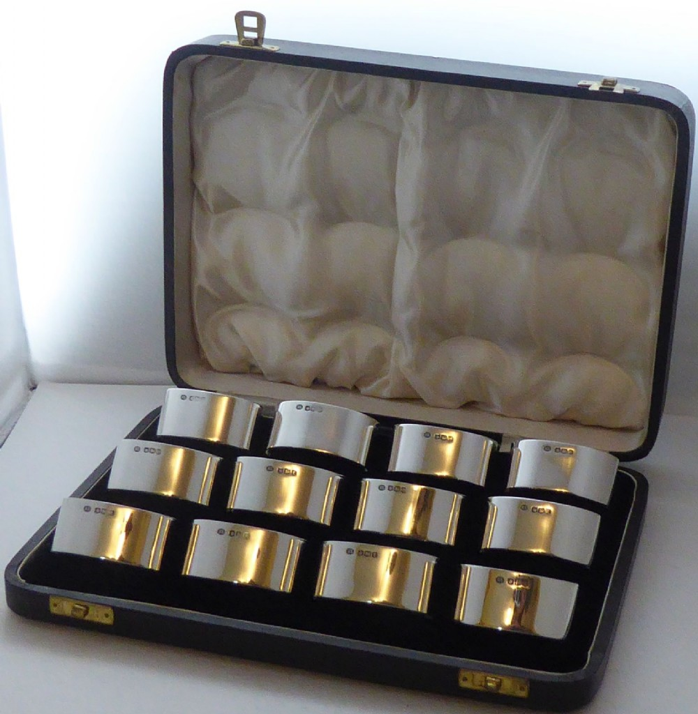 boxed set 12 solid 1936 hallmarked silver napkin or serviette rings 4227 grams