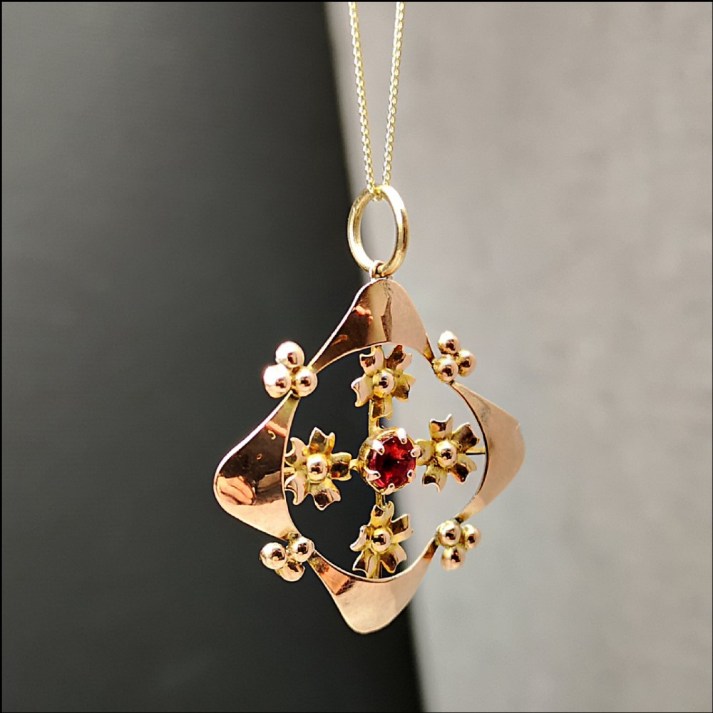 9ct edwardian rose gold and garnet pendant with chain