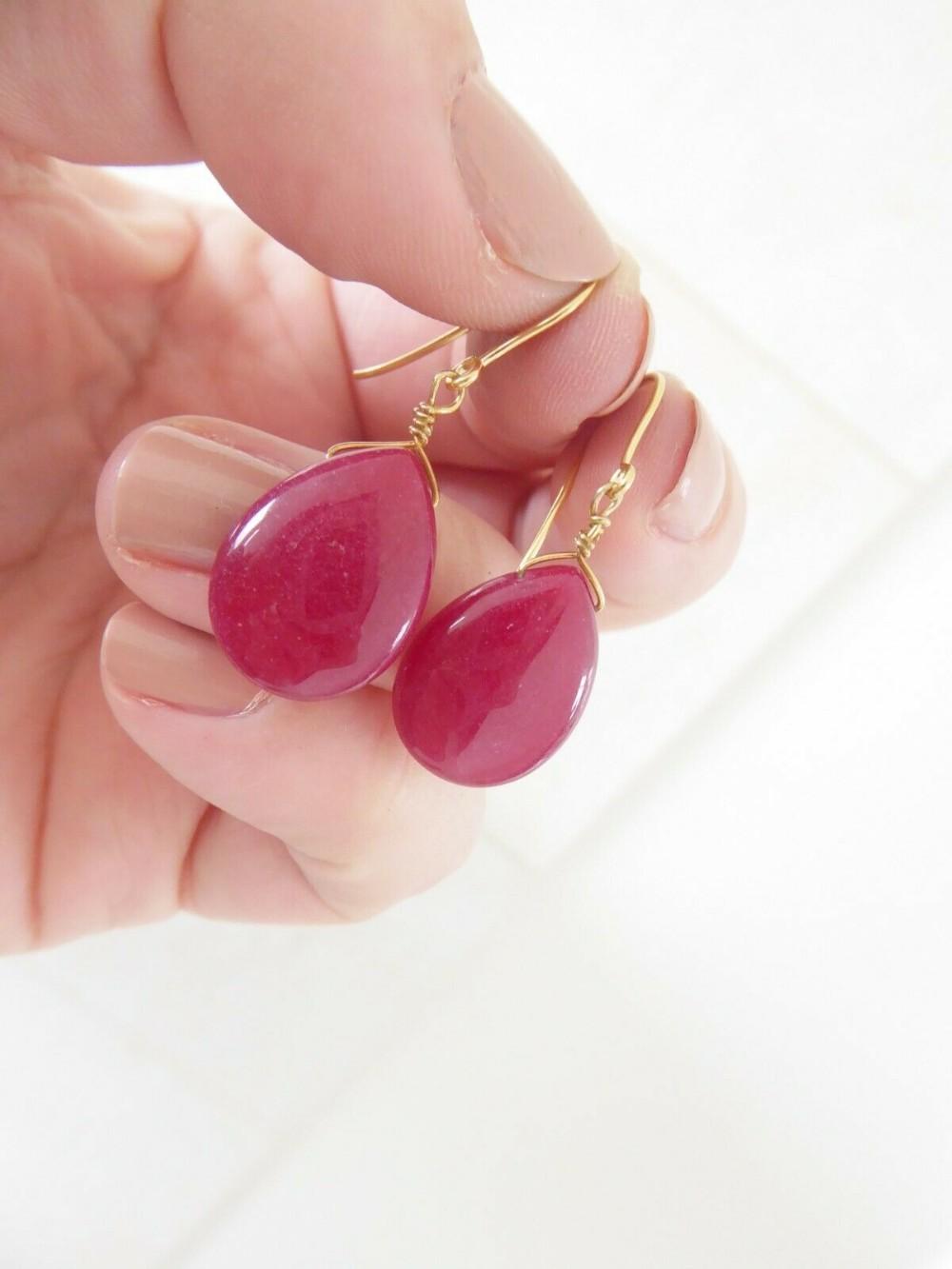 fine pair of 9ct gold pear drop ruby drop earrings