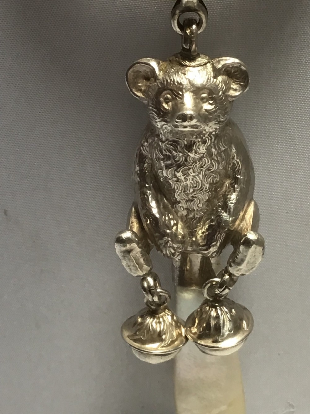 excellent solid silver bear rattle