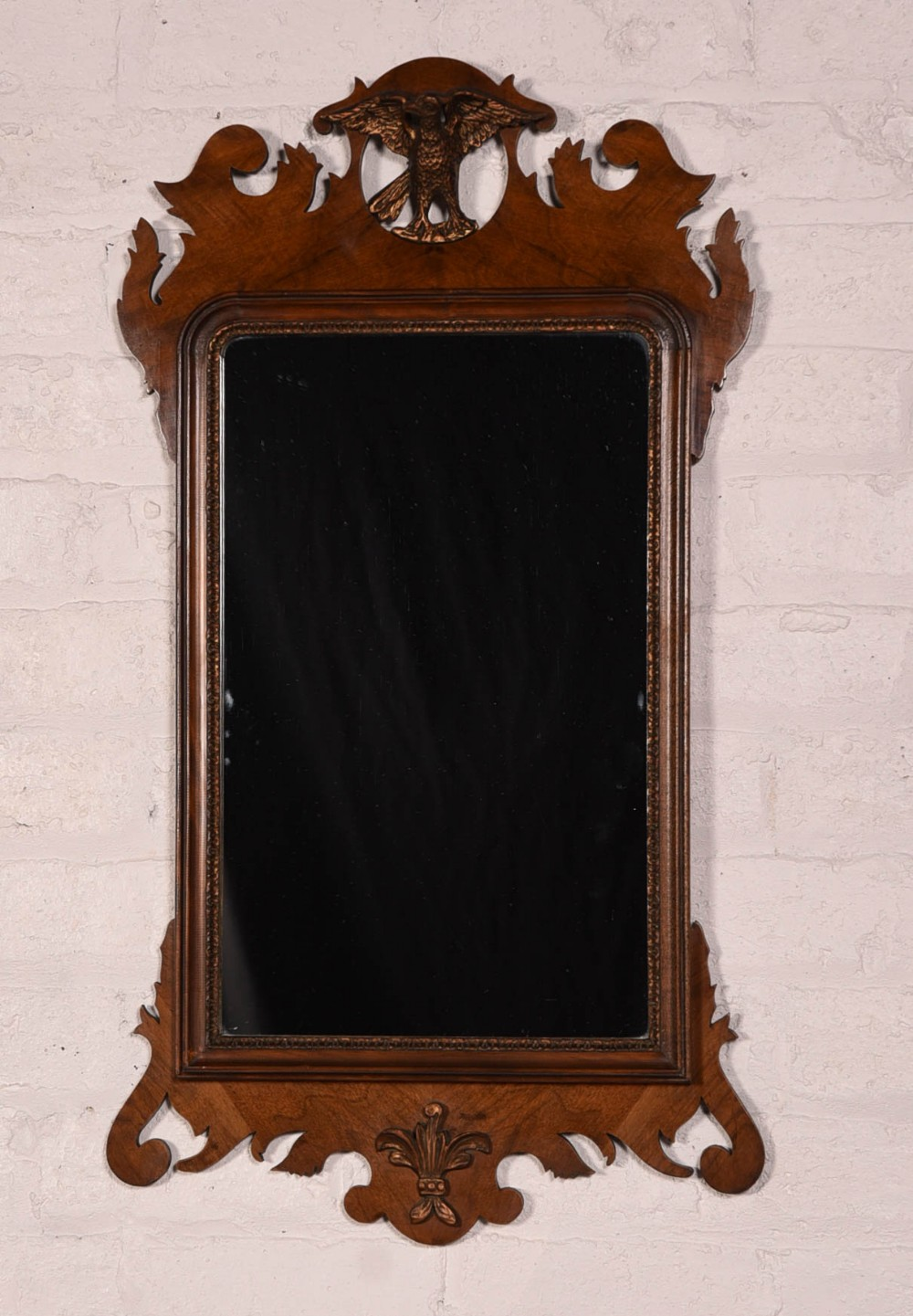 a chippendale style walnut wall mirror